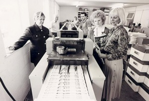 Pauline Jacks showing visitors the Brownhills Gazette being collated. Image very kindly supplied by John Sylvester.