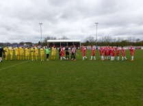 Customary handshake, with Shepshed in bright yellow,