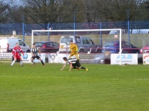 The match hots up as Walsall Wood challenge Heanor defence. Super!