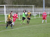 Walsall Wood attack as Rocester keeper shows confidence in the heavy ground conditions.