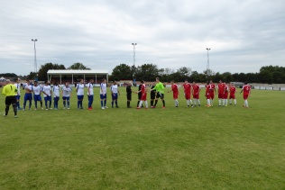 Today's visitors and the home team shake hands before the match got under way