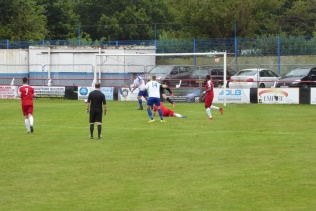 Some necessarily superb goal keeping as Coleshill adapt to the sodden surface.