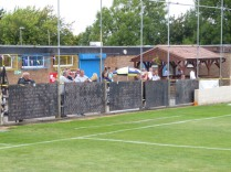 "Well-hydrated spectators, seen here before the kick-off, being entertained by the strains of ""its raining men"" from over the Tannoy. Love Tividale and their welcome."