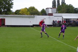Wood's player rises higher to head the ball