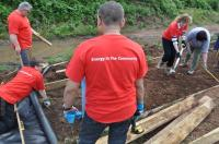 Volunteers from E.ON levelling the ground and laying timber edging on the Heritage Towpath Trail at Summerhill