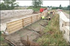 Shuttering is put in place by Waterway Recovery Group volunteers before the concreting of the canal wall over the Cranebrook culvert at Summerhill