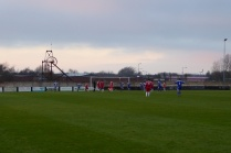 Yes, another goal to Shawbury. Home spectators mumble sweet nothings in to their mufflers .