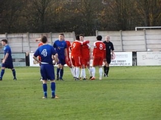 And the Wood celebrate the goal. Stourport are not disheartened if somewhat frustrated