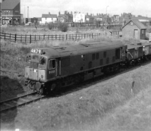 A cracking shot sent to me by Trevor Shakespeare showing a Class 25 loco (number D5223, later 25073) at Walsall Wood station in about 1964. The loco is facing towards Aldridge near the Lichfield Road bridge, on a train of 16-ton mineral wagons. The Aldridge - Walsall Wood branch closed to passengers in 1930 and the line became a freight-only branch, being singled and terminated at the colliery just north of Walsall Wood station (the line formerly ran to Brownhills Watling Street station and on to Chasewater). The branch closed completely shortly after January 1965, so this may have been one of the very last trains to use the branch.