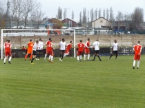 A throng of players, a tangle of legs, and Khalsa score their goal after putting the Wood under pressure
