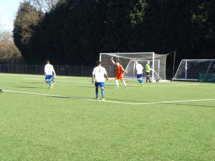 The home team go strangely silent here, as amazingly a clear handball by the defender goes unseen One of those games.