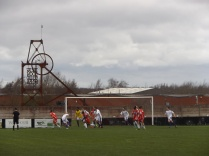 First half and a corner kick to the Wood. A nearby pigeon holds his breath