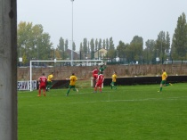 Wood score another goal in the persistent rain.