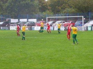 The late stage of the game. Another goal- and some concern by Bolehill players