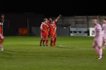 The Wood celebrate their second goal.