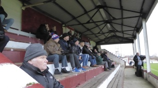 Winter and woolly hats for the choir of angels, sat sitting in the stand. Love local soccer.